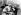 """Shirley Temple (1928-2014), actrice américaine, posant avec le chien-vedette de """"L'Appel de la forêt"""", film de William A. Wellman adapté du roman de Jack London. Etats-Unis, 28 septembre 1935. © TopFoto/Roger-Viollet"""