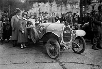 Lejeune driving a B.N.C. car at the starting line of the Paris-Pyrénées-Paris motor race, 1923. © Maurice-Louis Branger/Roger-Viollet