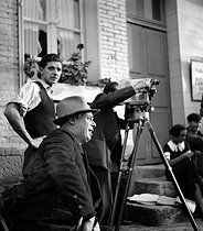 "Shooting of ""Madame Bovary"" by Jean Renoir, 1933. Jean Renoir, in the foreground, and Claude Renoir, operator, on the left. © Roger-Viollet"