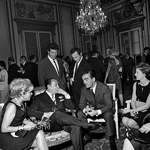 Tino Rossi (sitting, centre, 1907-1983), French actor and singer, talking to Michel Droit (1923-2000), French journalist, November 1963. © Claude Poirier / Roger-Viollet