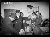 """Spanish Civil war (1939-1936). """"La Retirada"""". Albert Sarraut (1872-1962), French Minister of the Interior, and Marc Rucart (1893-1964), French Minister of Health, visiting Spanish refugees. Arles-sur-Tech (France), on January 31 - February 1st, 1939. Photograph from the Excelsior newspaper. © Excelsior – L'Equipe/Roger-Viollet"""