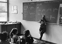 Spelling lesson. Example: Une petite fille née dans une rose (A little girl was born in a rose). Paris suburbs. 1967. Photograph by Janine Niepce (1921-2007). © Janine Niepce / Roger-Viollet
