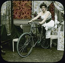 """Before the departure"", young woman wearing a négligé and posing with her bike. Around 1900. © Léon et Lévy / Roger-Viollet"