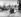 Guerre 1939-1945. Front de Normandie. Convoi américain transportant des troupes par un chemin détourné pendant que le génie répare un pont dynamité, 25 juillet 1944. © Jacques Boyer/Roger-Viollet