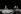 """Conférence de presse du mouvement féministe """"Choisir"""", avec François Mitterrand (candidat pour les présidentielles) et Gisèle Halimi (1927-2020), avocate et militante féministe française. Paris, 1981 Photographie de Janine Niepce (1921-2007). © Janine Niepce / Roger-Viollet"""
