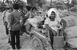 Cambodian War. Woman carrying sacks of rice. Cambodia, 1975. © Françoise Demulder / Roger-Viollet