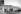 """Photographie de la police britannique en haut du mur de la prison Wandsworth de Londres d'où s'évada Ronald Arthur (Ronnie) Biggs, le """"cerveau"""" de l'attaque du train postal Glasgow-Londres en 1963. 8 juillet 1965. © TopFoto / Roger-Viollet"""