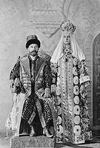 Tsar Nicholas II (1868-1918) and his wife Alexandra Fyodorovna (Alix of Hesse, 1872-1918), wearing the suits of Tzar Alexis I (1629-1676), during a fancy dress ball, 1903. © Albert Harlingue / Roger-Viollet