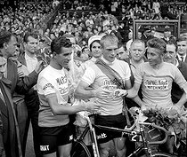 1962 Tour de France. From left to right: Federico Bahamontes (Spanish, King of the Mountains), Rudi Altig (German, green jersey) and Jacques Anquetil (French, winner of the Tour). © Roger-Viollet