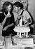 """Jane Fonda (née en 1937), actrice américaine, fêtant le 28ème anniversaire d'Alain Delon (né en 1935), acteur français, lors du tournage de """"Ni sains ni saufs"""". Paris, 11 novembre 1963. © TopFoto / Roger-Viollet"""