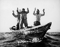 Korean War (1950-1953). Three Korean Communists in a fishing boat are captured by the USS Manchester off the coast of Korea. May 10, 1951. (Navy) © US National Archives / Roger-Viollet