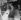 Jeune femme testant un portillon automatique pour entrer dans le métro à la station Stamford Brook. Londres (Angleterre), 3 janvier 1964. © TopFoto/Roger-Viollet