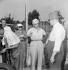 Luigi Villoresi (1909-1997) et Enzo Ferrari (1898-1988), pilotes automobiles italiens. Grand Prix d'Italie, 7 septembre 1952. © Alinari / Roger-Viollet