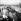 Guerre d'Indochine. Détachement blindé français avançant sur une route accompagné de porteurs indochinois. © Rikli Martin / Roger-Viollet