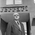 Enzo Ferrari (1898-1988), pilote automobile et industriel italien, devant le siège de son entreprise. Maranello (Italie). © Fedele Toscani / Alinari / Roger-Viollet