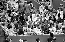 Jean-Loup Dabadie, writer and journalist (on the left, 4-th row) and Jean-Paul Belmondo, attending a semifinal of the French Open. On the right: Caroline of Monaco and Philippe Junot. Paris, Roland-Garros, June 8, 1979. © Roger-Viollet