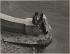 Couple on the bank of the river Seine, at the quai du Louvre. Paris (Ist arrondissement), before 1940. Photograph by Jean Roubier (1896-1981). Bibliothèque historique de la Ville de Paris. © Jean Roubier/BHVP/Roger-Viollet