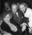 """Colette (1873-1954), écrivain français, André Luguet (1892199), acteur français, et Hélène Perdrière (1912-1992), actrice française, lors de la première de """"La Seconde"""", d'après l'oeuvre de Colette. Paris (VIIIème ar.), Théâtre de la Madeleine, 1951. © Ullstein Bild/Roger-Viollet"""