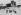 Guerre 1939-1945. Front de Normandie, 10 juin 1944. Troupes américaines arrivant des dunes de Varreville (Utah Beach) rassemblés dans une cour de ferme dont ils viennent de déloger les tireurs allemands. © Roger-Viollet