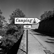 "Signpost ""Camping"". The French Riviera. October 1957. © Roger-Viollet"