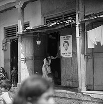 Poster of the Congress Party presenting Indira Gandhi (1917-1984) on the door of a prostitute's shop. Bombay (India), March 1972. © Roger-Viollet