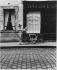 Old woman pushing a doll in a pram, rue Piat. Paris (XXth arrondissement), 1966. Photograph by Léon Claude Vénézia (1941-2013). © Léon Claude Vénézia/Roger-Viollet