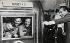 Equipage d'Apollo-11 : Neil A. Armstrong, Michael Collins et Edwin E. Aldrin Jr.. Visite du président Richard Nixon à l'équipage après leur sortie de quarantaine. USS Hornet, pacifique du Sud. 24 juillet 1969. © The Image Works/Roger-Viollet