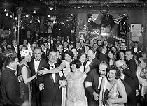 "New Year's Eve at the restaurant ""Maxim's"". Paris, 1925. © Maurice-Louis Branger / Roger-Viollet"
