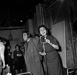 """Suzy Delair (Suzanne Pierrette Delaire, née en 1916) et Fernandel (1903-1971), acteurs français, pendant le tournage du """"Couturier de ces dames"""" de Jean Boyer. 1956. © Alain Adler / Roger-Viollet"""