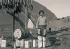 Jeune Inuit à un point de ravitaillement d'essence pour hydroglisseurs. Groënland, vers 1925. © Imagno/Roger-Viollet