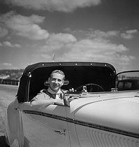 Charles Trenet (1913-2001), French singer-songwriter, aboard a Delage convertible car designed by Figoni-Falaschi. Deauville (France), August 1939. © Boris Lipnitzki / Roger-Viollet