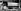 Guerre 1939-1945. Aviateurs américains accrochant l'une des bombes atomiques pour les larguer sur les villes japonaises d'Hiroshima et de Nagasaki, le 6 août 1945. © TopFoto/Roger-Viollet