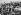 Guerre 1939-1945. Débarquement en Provence. Soldats américains et allemands recevant les premiers secours sur une plage. 17 août 1944. © Collection Roger-Viollet / Roger-Viollet