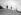Guerre 1939-1945. Concours de pêche au lancer pour la truite. Le doyen de la compétition, Louis Perrot, célèbre marchand d'articles de pêche, et son petit-fils. Paris, 13 juillet 1941. © LAPI/Roger-Viollet