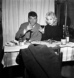 "Mylène Demongeot and Henri Vidal during the shooting of ""Sois belle et tais-toi"" by Marc Allégret. France, 1957.    © Roger Berson / Roger-Viollet"
