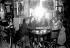In a café of the Montparnasse district. Middle : Aïcha la Noire, model. Paris, around 1925. © Albert Harlingue / Roger-Viollet