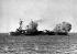 """Guerre 1939-1945. Le cuirassé """"Rodney"""" de la Royal Navy bombardant des positions ennemies terrestres. Près de Caen (France), 7 juin 1944. © TopFoto / Roger-Viollet"""