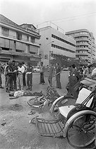 Cambodian War. Civilian killed by the last rockets launched before the fall of the city. Phnom Penh, on April 14, 1975.  © Françoise Demulder / Roger-Viollet