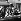 """Tournage du film """"A bout de souffle"""" de Jean-Luc Godard. Jean-Paul Belmondo et Jean Seberg. Paris, septembre 1959.  © Alain Adler / Roger-Viollet"""
