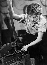 Apprenticeship. Young boy using shears, 1949. © Jacques Boyer / Roger-Viollet