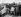 Policiers et photographes autour de la carcasse du véhicule après l'accident ayant coûté la vie du pilote automobile anglais Mike Hawthorn (1929-1959). Angleterre, 22 janvier 1959. © TopFoto / Roger-Viollet
