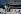 Couple assis près d'un bateau, sur les quais. Paris, avril 1968. Photographie de Gösta Wilander (1896-1982). Paris, musée Carnavalet. © Gösta Wilander / Musée Carnavalet / Roger-Viollet