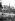 Déchargement d'une péniche devant la cathédrale Notre-Dame. Paris, 1940. © LAPI / Roger-Viollet