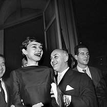 Audrey Hepburn (1929-1993), British actress, and Ray Ventura (1908-1979), French conductor. Paris, on February 22, 1955.      © Alain Adler / Roger-Viollet