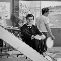 "Guy Bedos (1934-2020), French actor on the set of ""Ce soir ou jamais"", film by Michel Deville (born in 1931). France, 1961. © Alain Adler / Roger-Viollet"