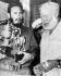 Fidel Castro (1926-2016), révolutionnaire et homme d'Etat cubain, tenant les trois coupes remportées lors du tournoi de pêche d'Ernest Hemingway (1899-1961), écrivain américain. La Havane (Cuba), 16 mai 1960. © TopFoto / Roger-Viollet