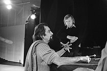 "Maurice Béjart (1927-2007), French dancer and choreographer, with Karlheinz Stockhausen (1928-2007), German composer. Rehearsal of ""Stimmung"". Brussels (Belgium), Théâtre de la Monnaie, March 1975. © Colette Masson/Roger-Viollet"
