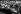 """Cérémonie de la pose de la première pierre de l'usine Volkswagen à Fallersleben. Adolf Hitler (188-1945), homme d'Etat allemand, inspectant une voiture KdF """"La Force par la Joie"""". A ses côtés : le docteur  Robert Ley, l'ingénieur automobile Porsche, commandant général Julius Schaub, chef de l'Etat-major Viktor Lutze, le lieutenant-général Martin Bormann et Alfred Rosenberg. Environs de Wolfsburg (Allemagne), 26 mai 1938. © Ullstein Bild / Roger-Viollet"""