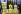 """Berlin, des membres de Greenpeace, dont le slogan est """"l'énergie nucléaire est un leurre"""", manifestent  contre le contrat de coalition du SPD et des alliances des verts, qui sera signé dans la galerie nationale. 16 octobre 2002. © Ullstein Bild/Roger-Viollet"""