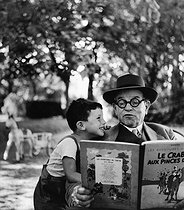 Two big Tintin lovers : Janine Niepce's father and her son. Rully (France), 1952. Photograph by Janine Niepce (1921-2007). © Janine Niepce/Roger-Viollet